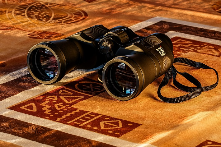A pair of binoculars on a table in a cruise ship lounge