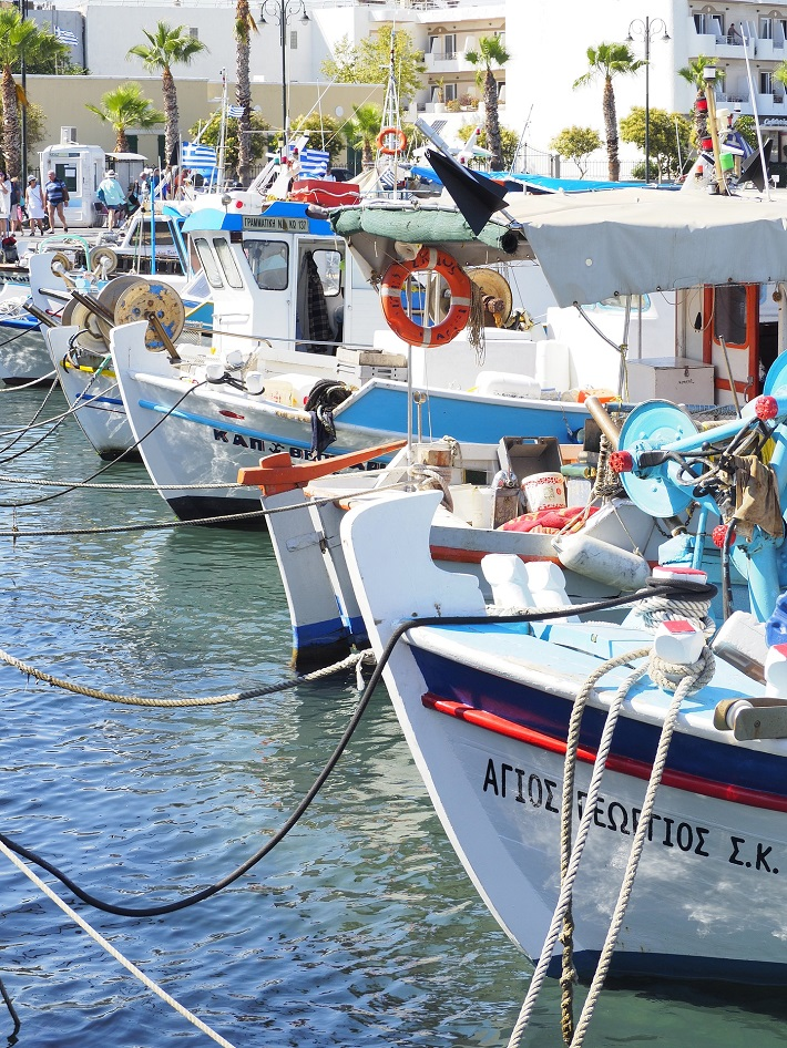 Quaint boats floating in the harbour in Kos