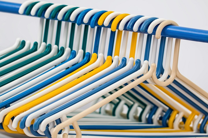 Coat hangers on a clothes rail in the wardrobe on-board a cruise ship