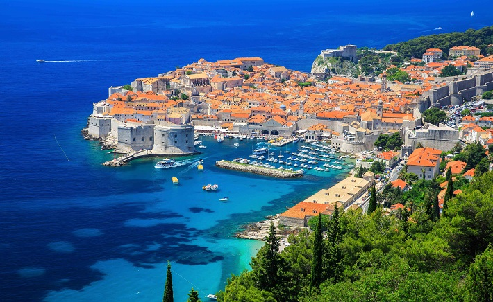Panoramic view of Dubrovnik's lush hillsides and historic buildings