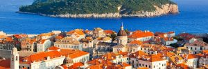 View out to a Croatian island from the orange rooftops of Dubrovnik