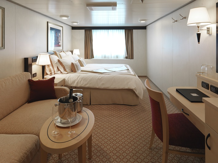 The sophisticated interior of an Oceanview room on-board a Cunard ship