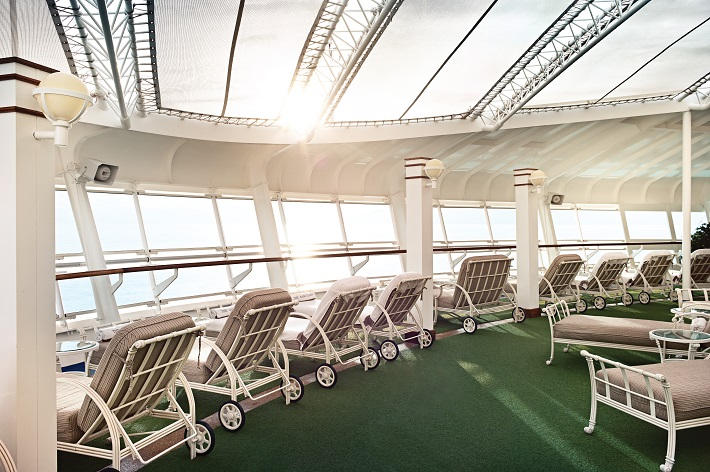 Sea-view sun-beds in the Sanctuary Lounge on a Princess Cruises ship