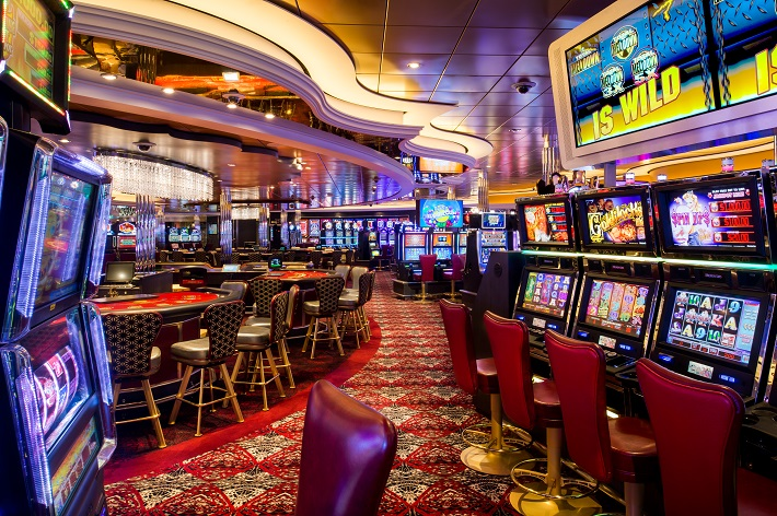 Card tables and slot machines in Casino Royale on a Royal Caribbean cruise ship