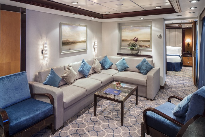 The plush living room in a four-bedroom Family Suite on-board Royal Caribbean's Independence of the Seas cruise ship