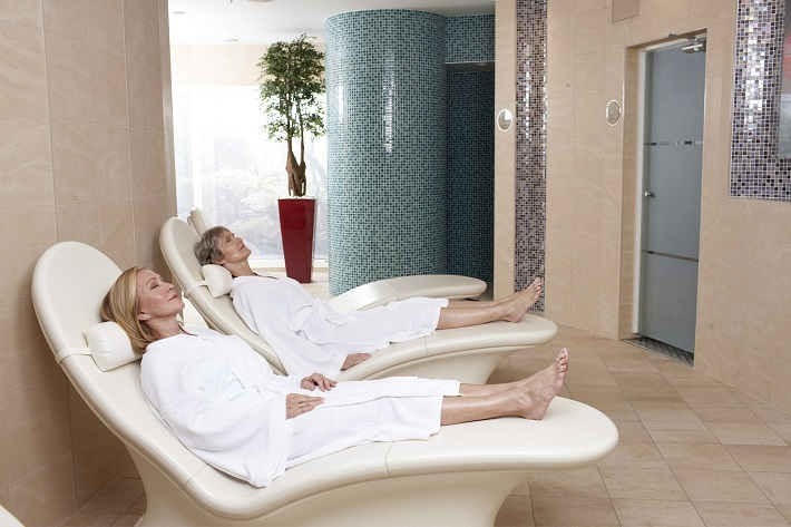 Women relaxing in the thermal room in the Vitality Spa on-board Independence of the Seas