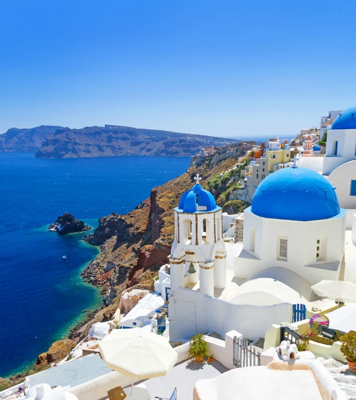 White and blue buildings on the cliffs of Santorini