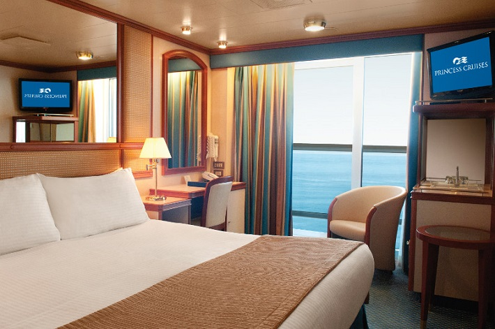 Bedroom area of a Balcony stateroom on-board Crown Princess