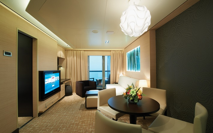 The contemporary living area in a Family Villa on-board a Norwegian Cruise Line ship