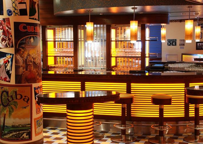 Vibrant bar area of the Havana bar on-board P&O Ventura