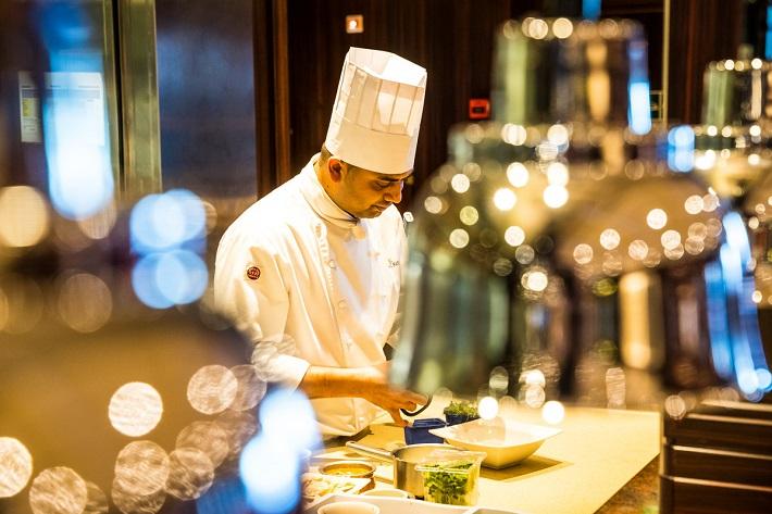A chef in P&O Ventura's Sindhu restaurant preparing food