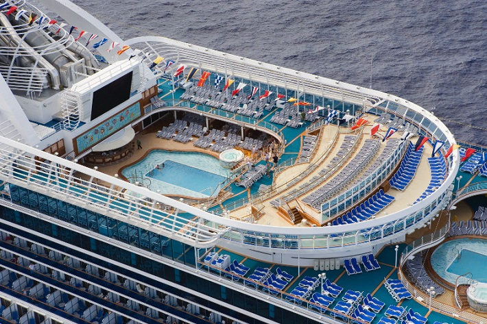 Aerial shot into the pool deck on-board Princess Cruises' Crown Princess cruise ship