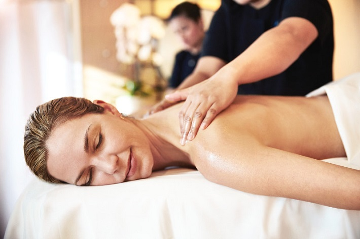 Woman having a massage in the Lotus Spa on-board Princess Cruises' Crown Princess