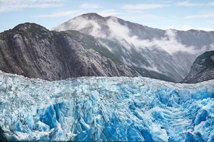 The huge Sawyer Glacier spilling out from the mountains in Alaska