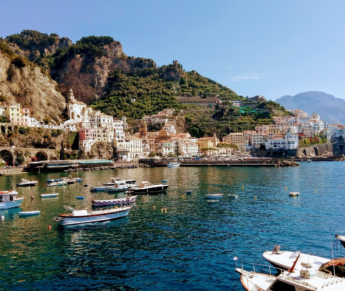 Boats bobbing in a picturesque harbour on the Amalfi Coast