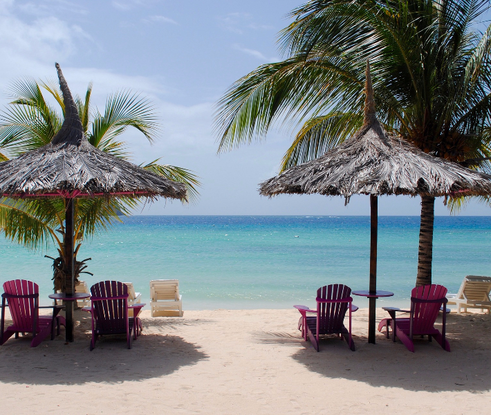 Beach chairs and sun loungers on a beach in the Caribbean