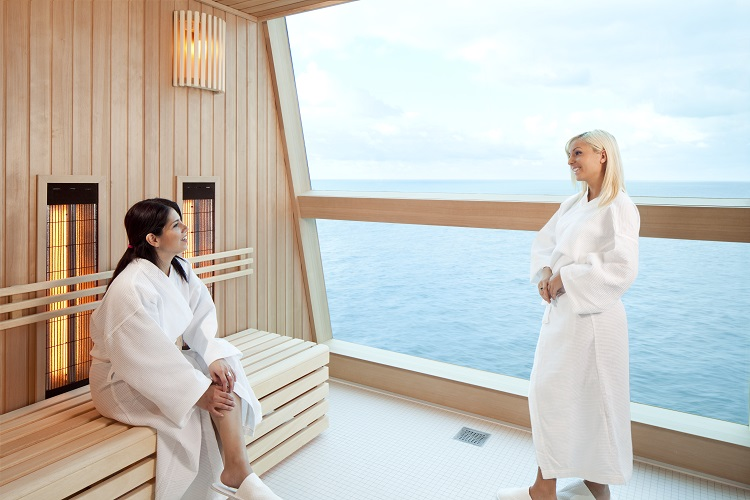 Two women talking in the infrared sauna in the spa on-board a Celebrity cruise ship