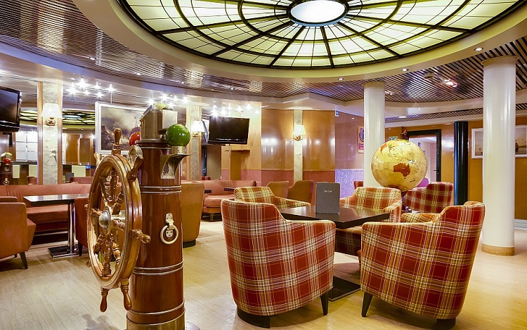 The traditional Columbus lounge on-board Cruise and Maritime's Marco Polo