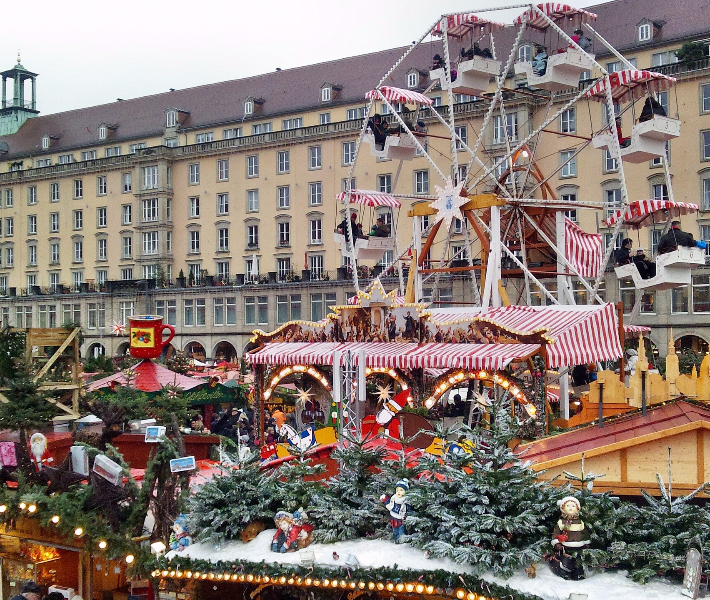 A ferris wheel and stalls at a Christmas market in Dresden
