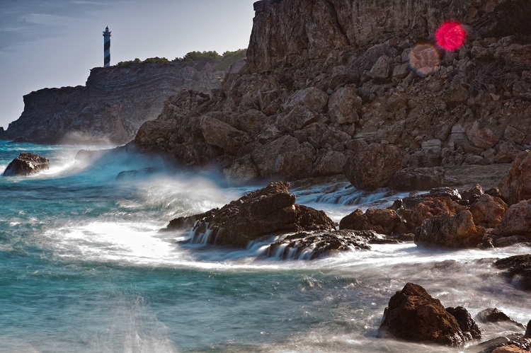Cliffs and waves on the coast of Ibiza