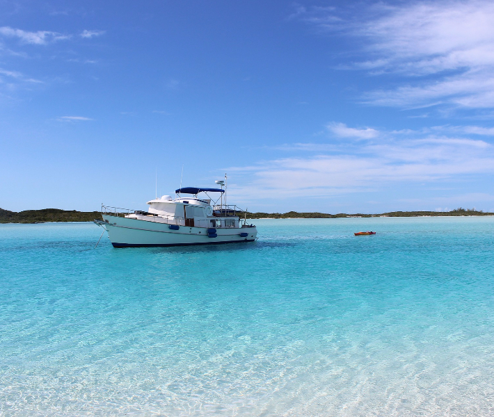 An island-hopping boat floating in the crystal-clear Caribbean sea