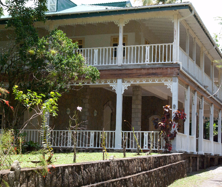 The exterior of a grand plantation house in the Caribbean