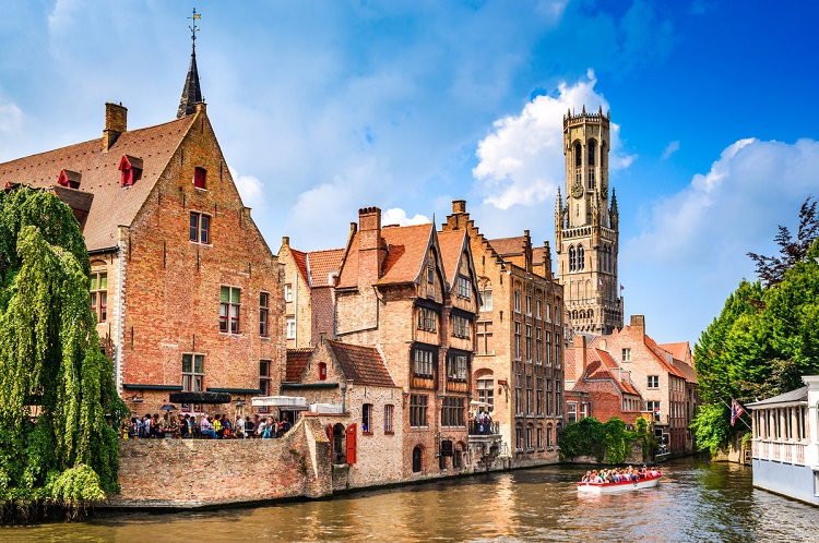 Houses lining a canal in Bruges - a PO Cruises destination
