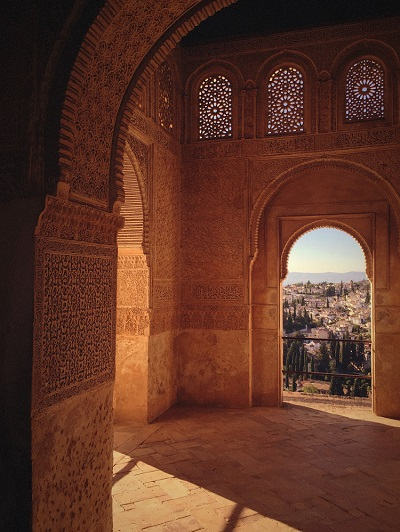 A doorway leading onto a scenic balcony in the Alhambra Palace in Granada on the Costa del Sol
