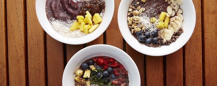A selection of healthy acai bowls on a table on a Celebrity Cruises ship