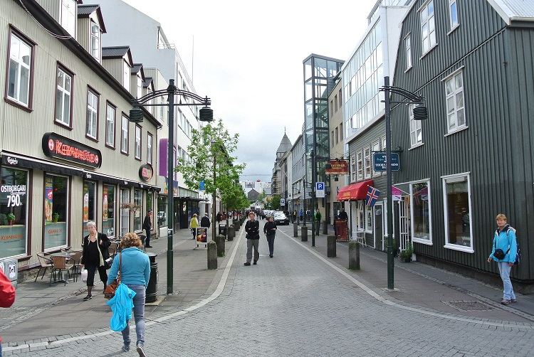 Visitors and locals walking along Laugavegur in downtown Reykjavik