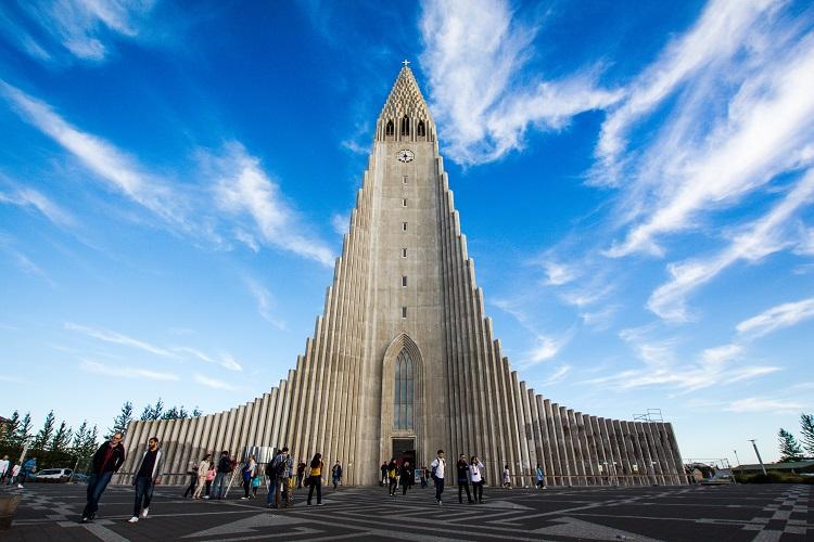 People walking into imposing Hallgrimskirkja in Reykjavik