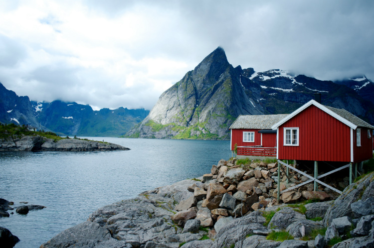 A traditional red house in the fjords of Norway