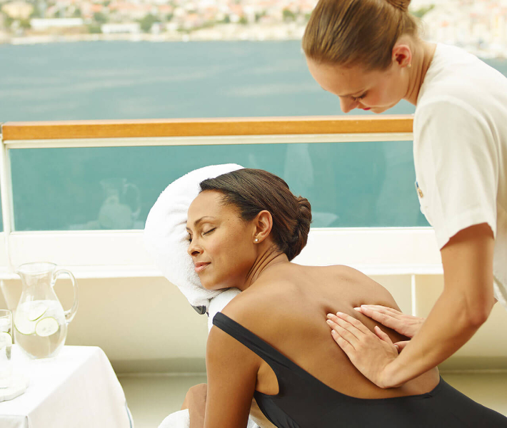 Woman being massaged on-board a cruise ship