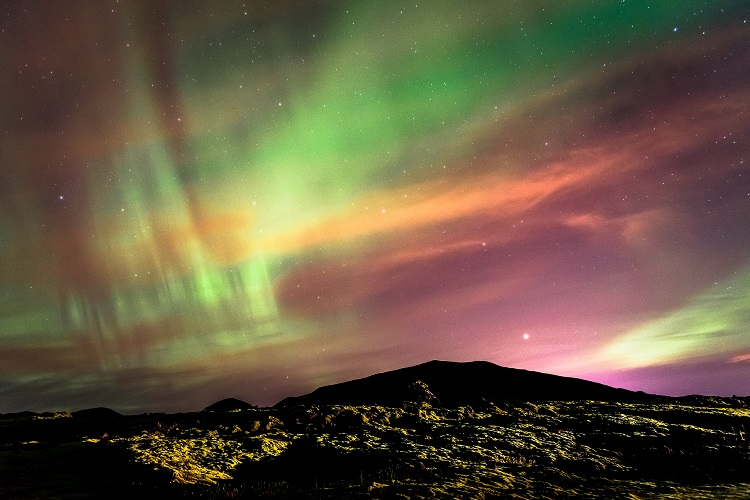 The Northern Lights shining over the lava fields near Reykjavik in Iceland
