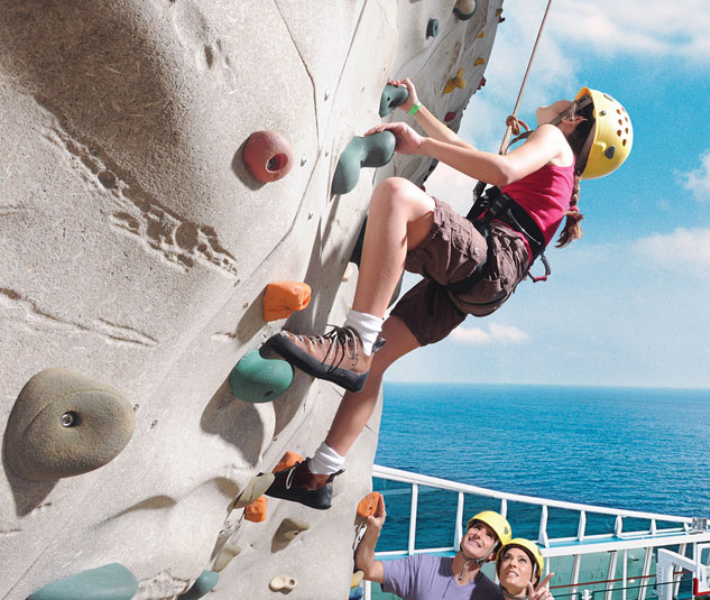 Enjoying rock climbing on-board Royal Caribbean