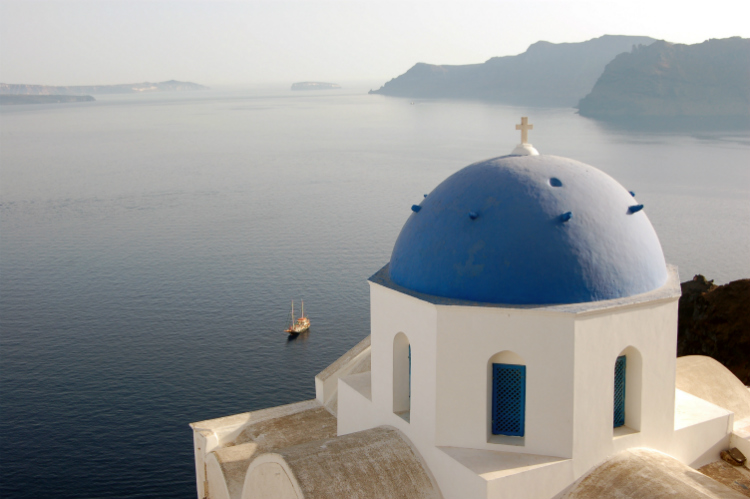 A blue and white church on the coast of Santorini