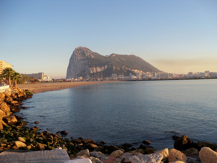The Rock in Gibraltar rising above the sea across an inlet