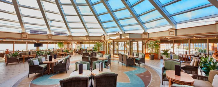 The bright and elegant Garden Lounge on-board Cunard Queen Elizabeth