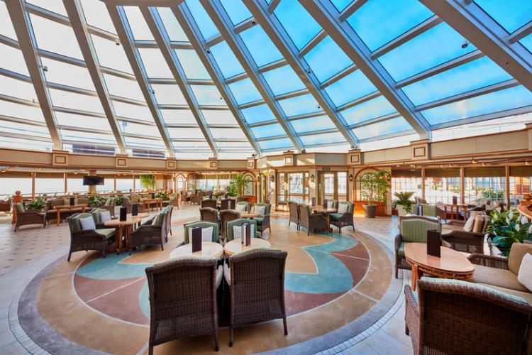 The bright and elegant Garden Lounge on-board Cunard Queen Elizabeth