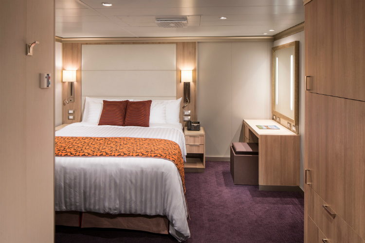 An elegant Inside stateroom on-board HAL's ms Oosterdam