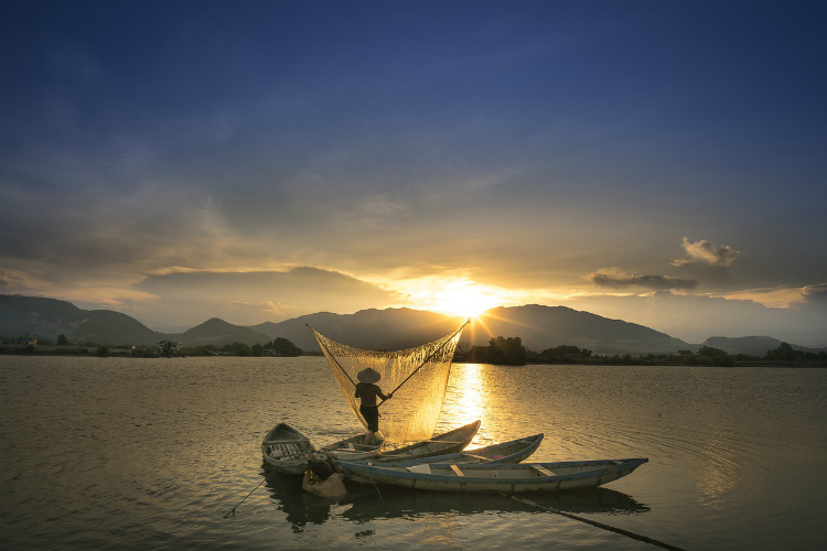 A local man fishing the traditional way on the Mekong River