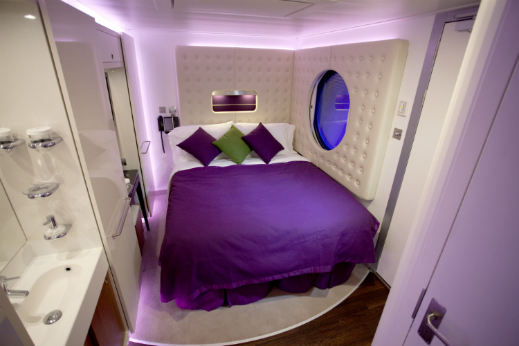 A brightly-coloured Studio stateroom on-board Norwegian Epic