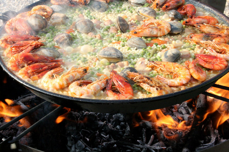 Seafood paella on a traditional stove in Valencia in Spain