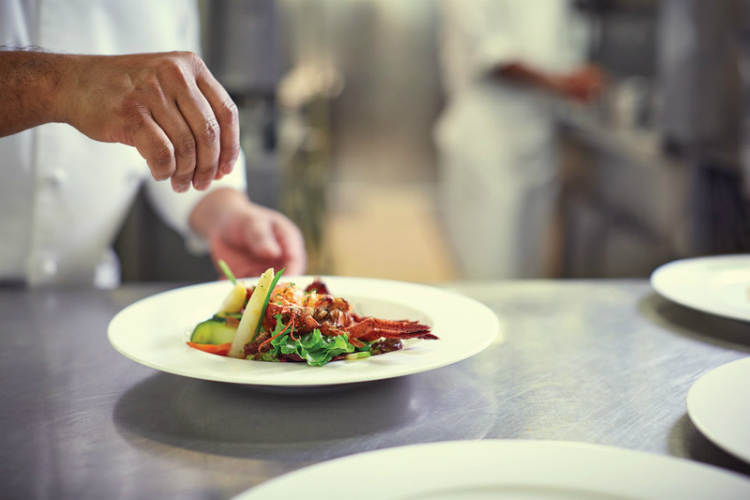 A chef preparing a dish on P&O Cruises' Azura