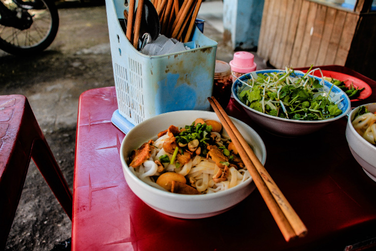 A bowl of authentic street food on a table in Ho Chi Minh City