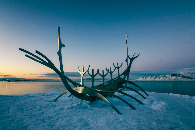 The Sun Voyager sculpture surrounded by snow in the harbour of Reykjavik cruise port