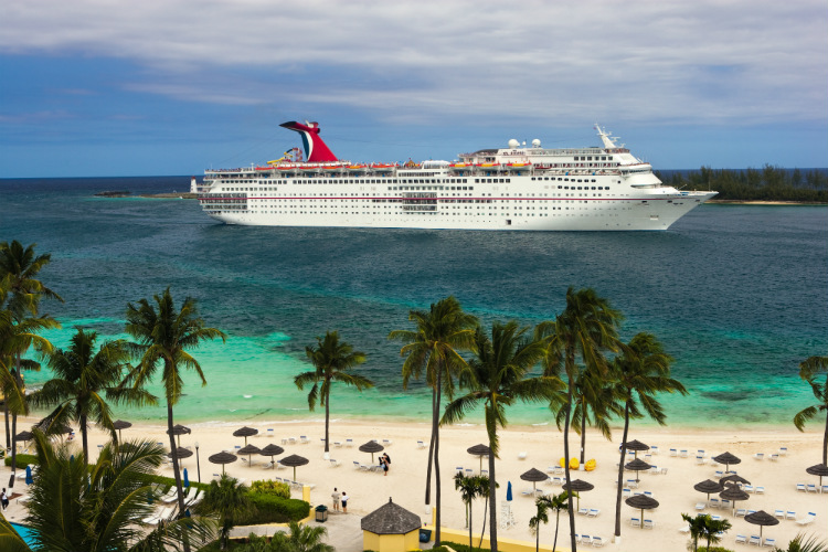 A Carnival cruise ship docked off the coast of a Caribbean island
