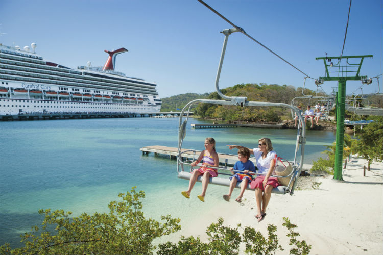 Family riding the chair lift in port, with Carnival Glory in the background
