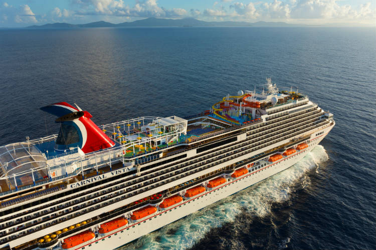 Carnival Vista sailing along the sea - Carnival's newest member of the fleet