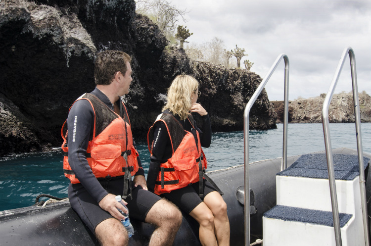 A couple on a Galapagos expedition with Celebrity Xperience on a Zodiac excursion